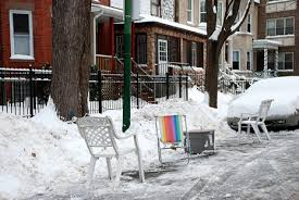 chair holding space on snowy street 2