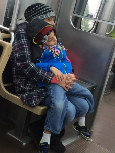 child sleeping on el